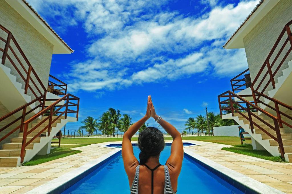 A piscina localizada em Manga Verde Beach Residence ou nos arredores