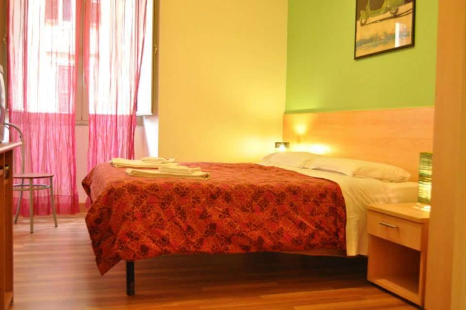 Letto o letti in una camera di L'Incanto Di San Pietro B&B