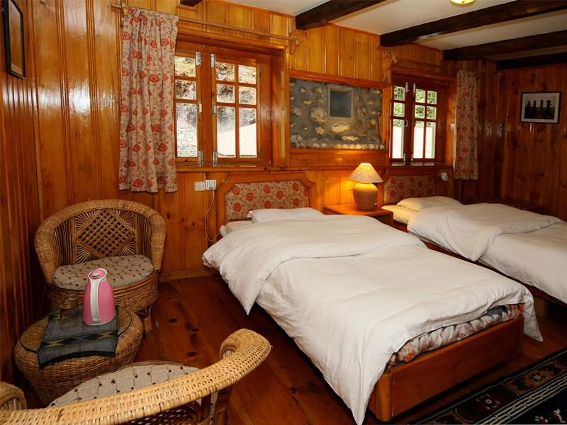 A bed or beds in a room at Yeti Mountain Home, Phakding