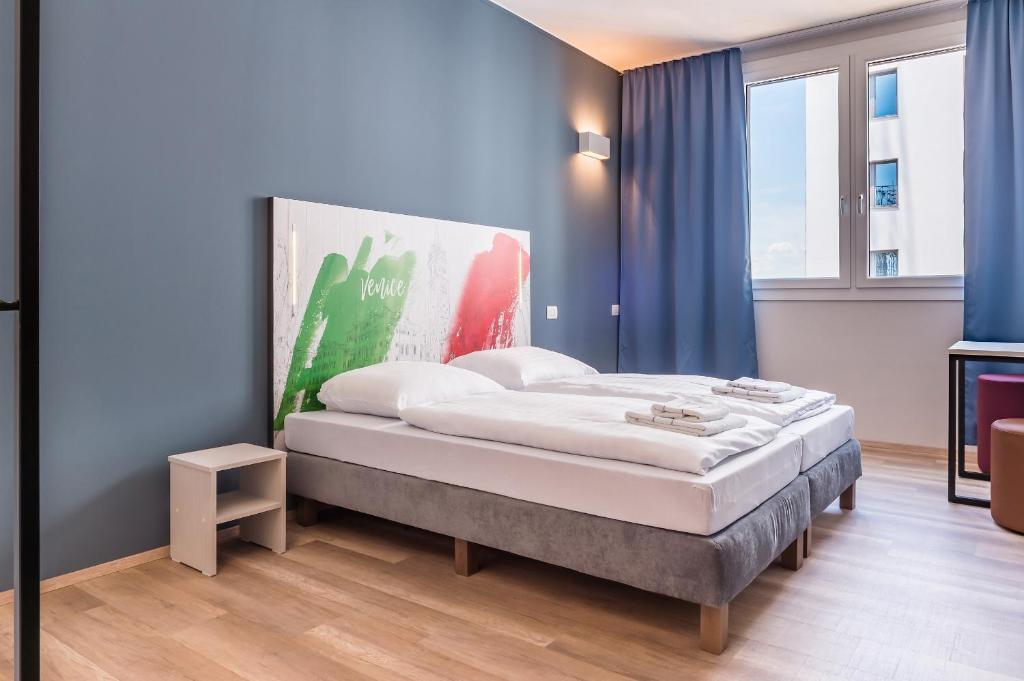 Łóżko lub łóżka w pokoju w obiekcie ao Hotel Venezia Mestre