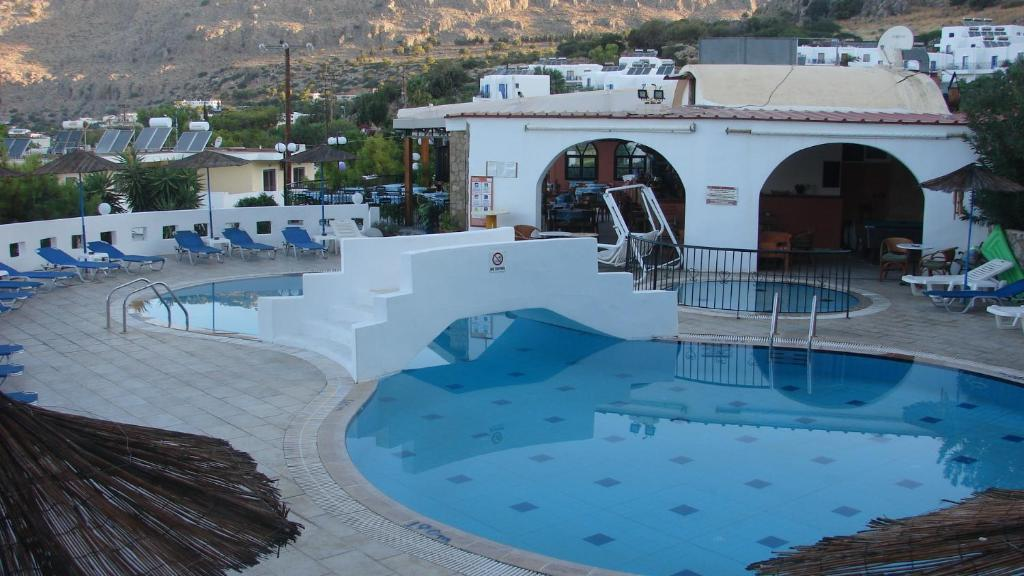 The swimming pool at or near Apostolis Hotel Apartments