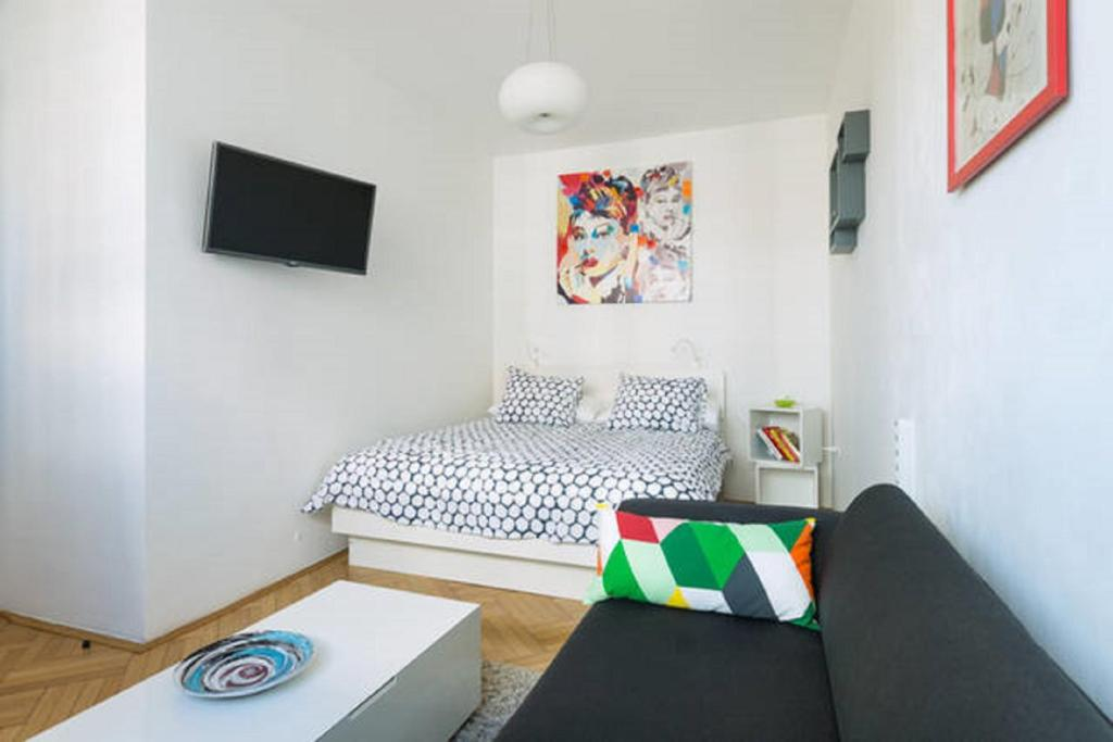 A bed or beds in a room at Colour View Apartment