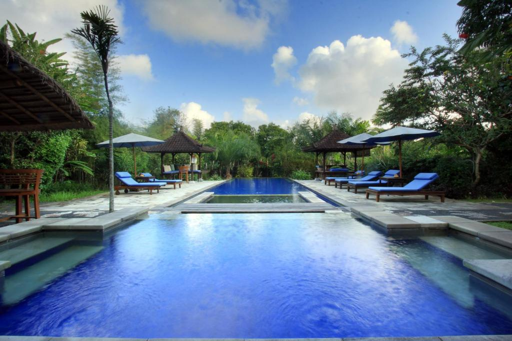 The swimming pool at or close to Nara Ubud Cottage