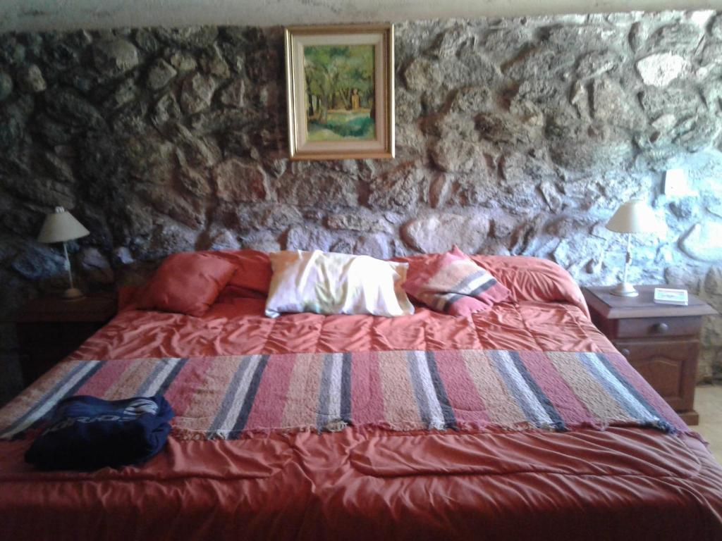 A bed or beds in a room at Ongamira Turismo Rural