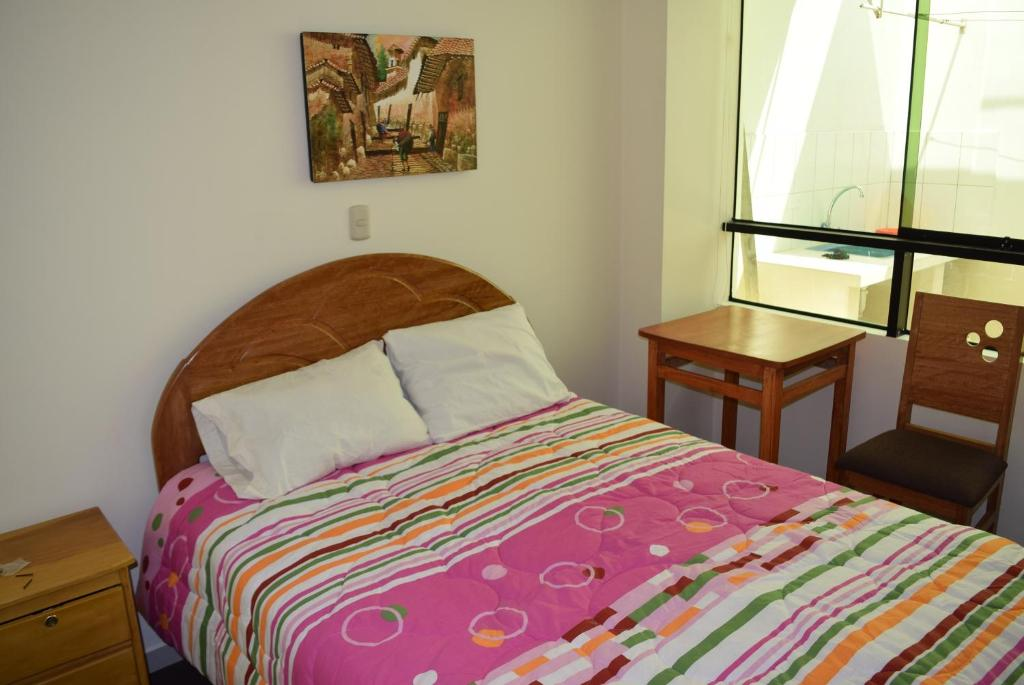 Cama o camas de una habitación en Kuski Hospedaje
