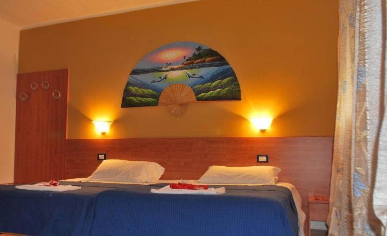 מיטה או מיטות בחדר ב-Laguna B&B