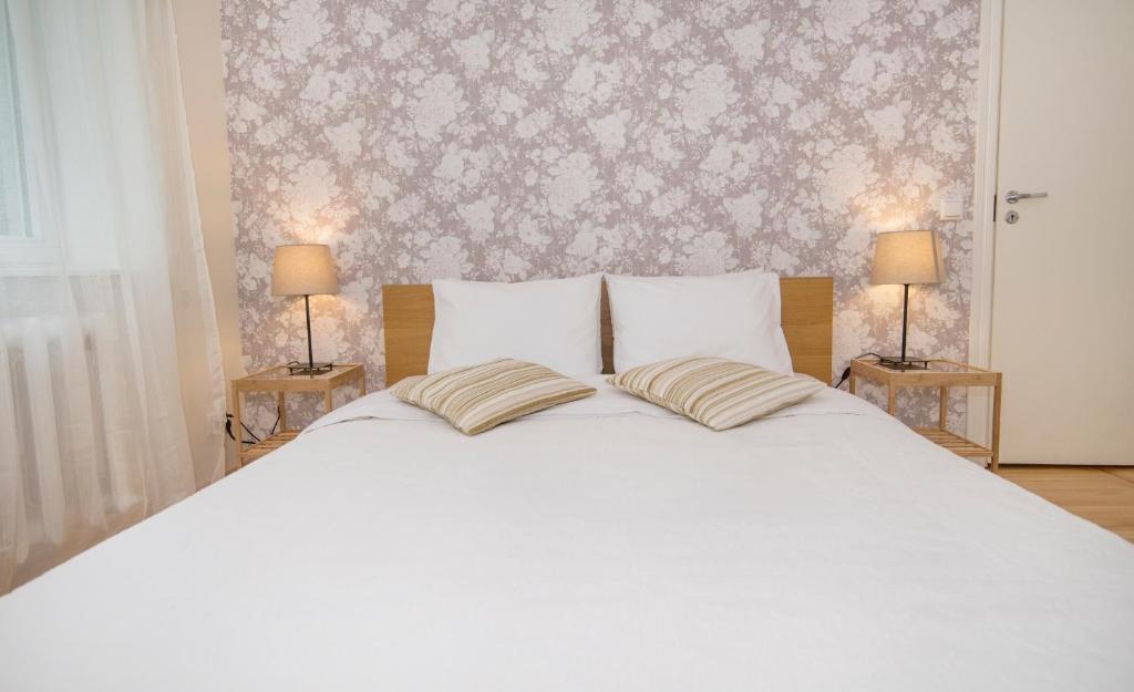 Кровать или кровати в номере Tanuma Home Rocca Al Mare