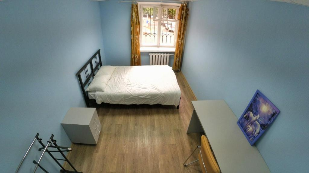 A bed or beds in a room at Hostel Ural Rover on Krylova