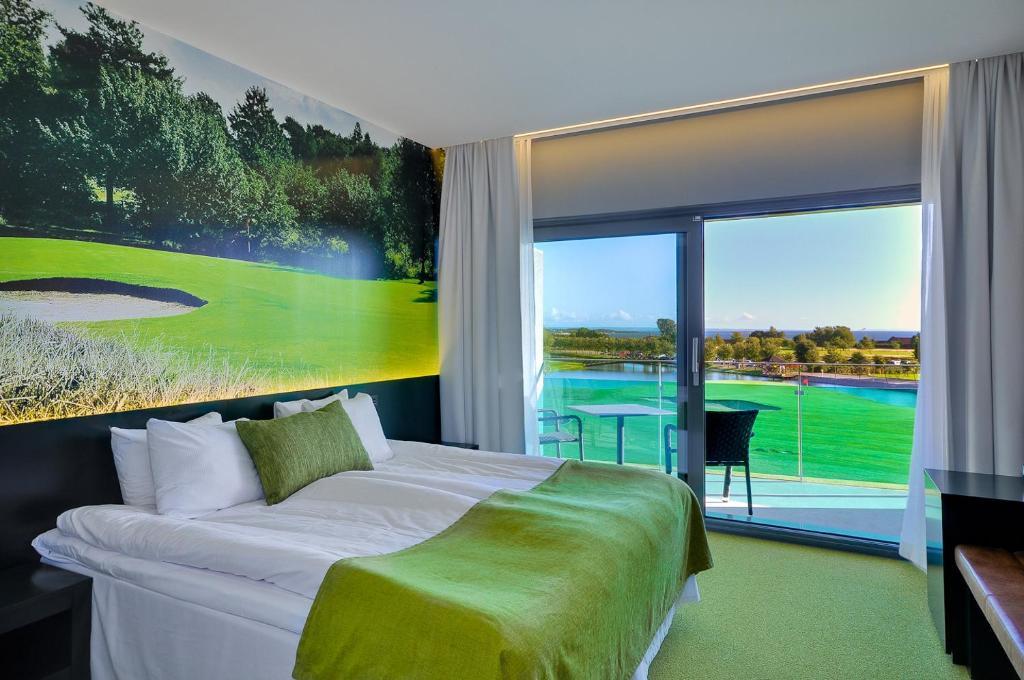 Säng eller sängar i ett rum på Ringenäs Hotell & Konferens