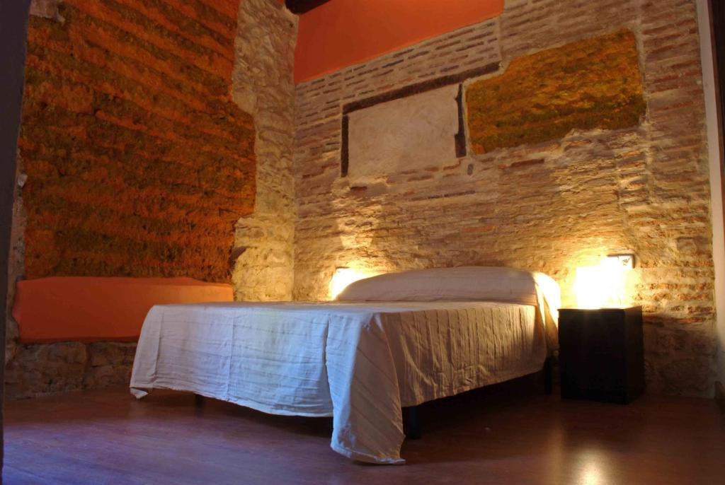 Cama o camas de una habitación en Hosteria Natura Plaza