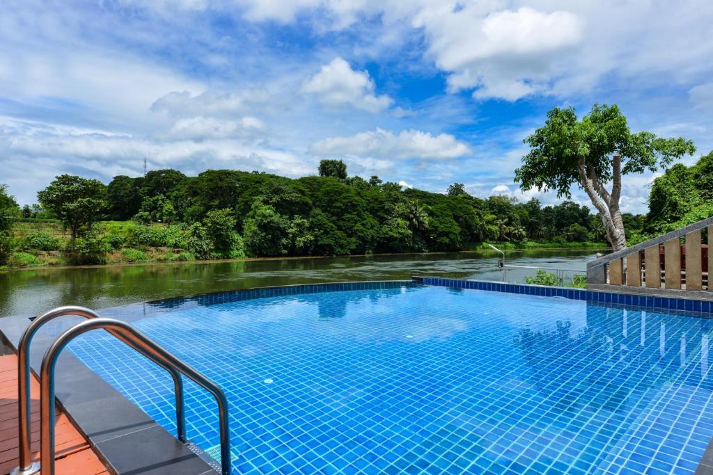 The swimming pool at or near Princess River Kwai Hotel