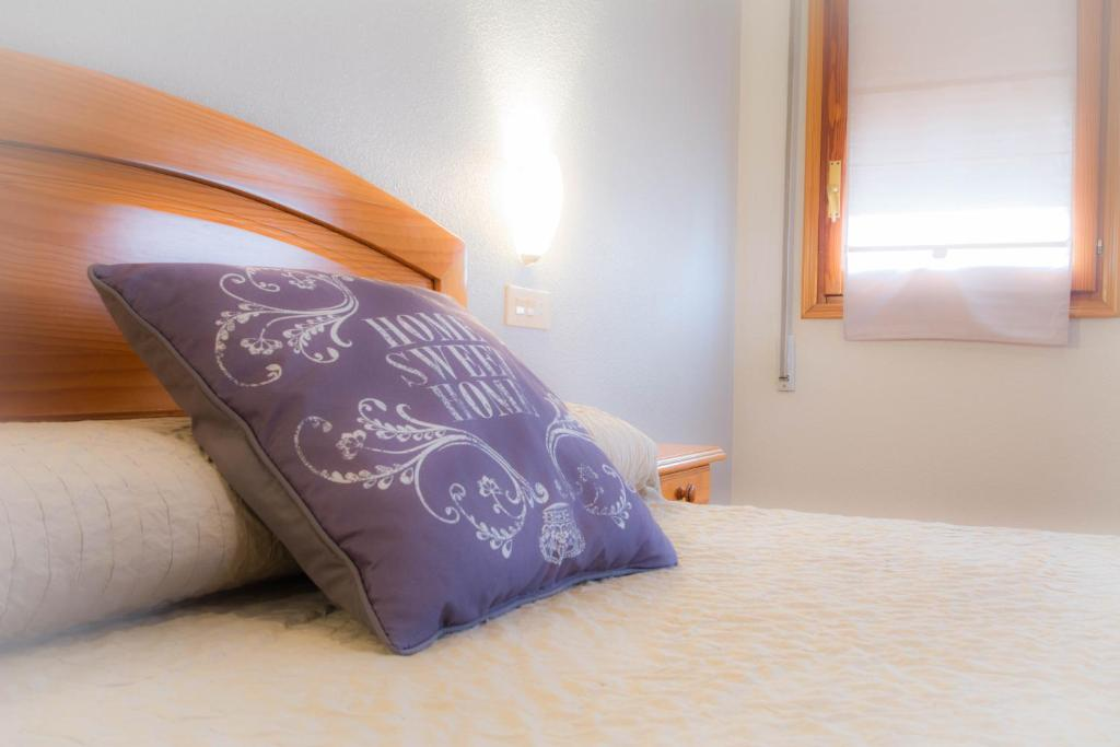 L'Oncle Pere Habitacionsにあるベッド