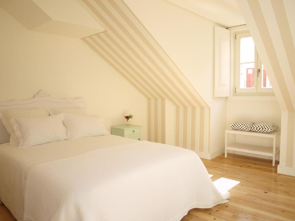 A bed or beds in a room at Madalena Hermitage