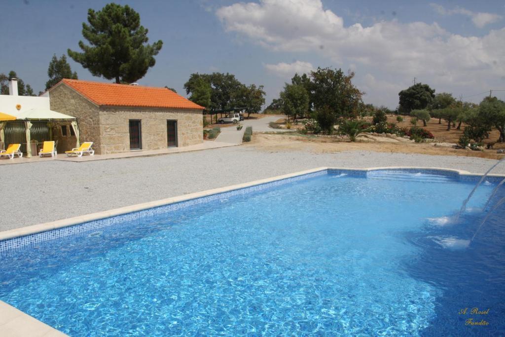 The swimming pool at or near Casa das Magnolias