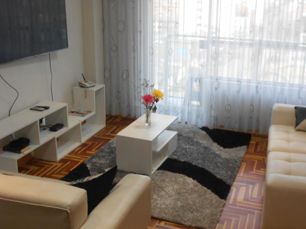 Zona de estar de Appartement meublé