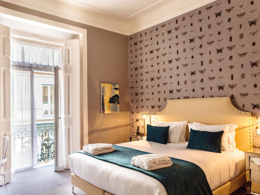 A bed or beds in a room at Dear Lisbon - Gallery House