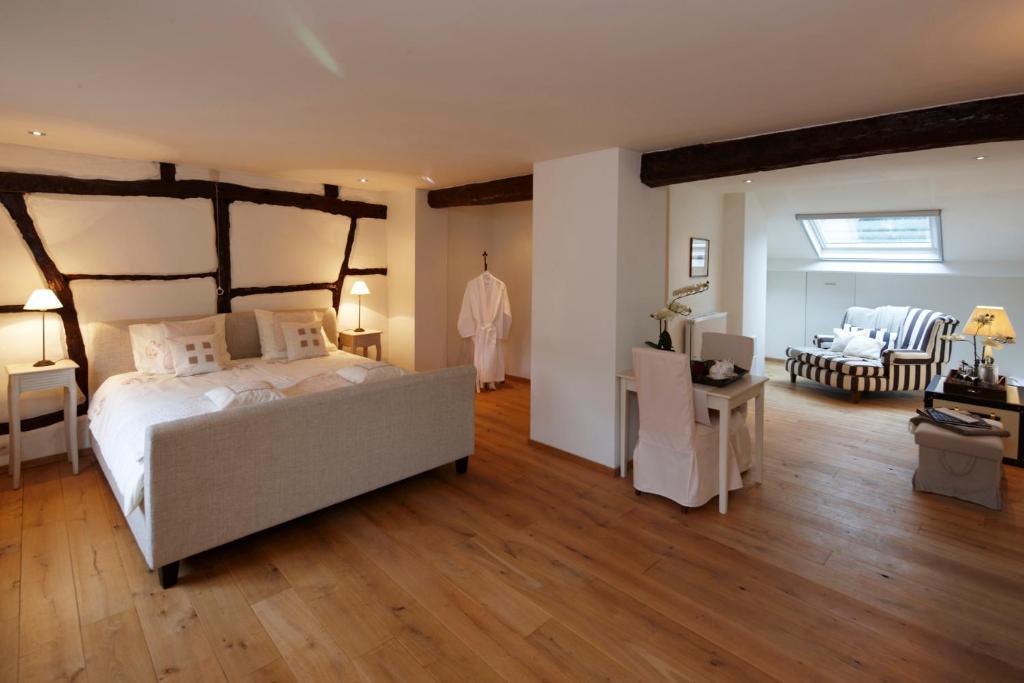 En eller flere senger på et rom på B&B Hof van Vervoering