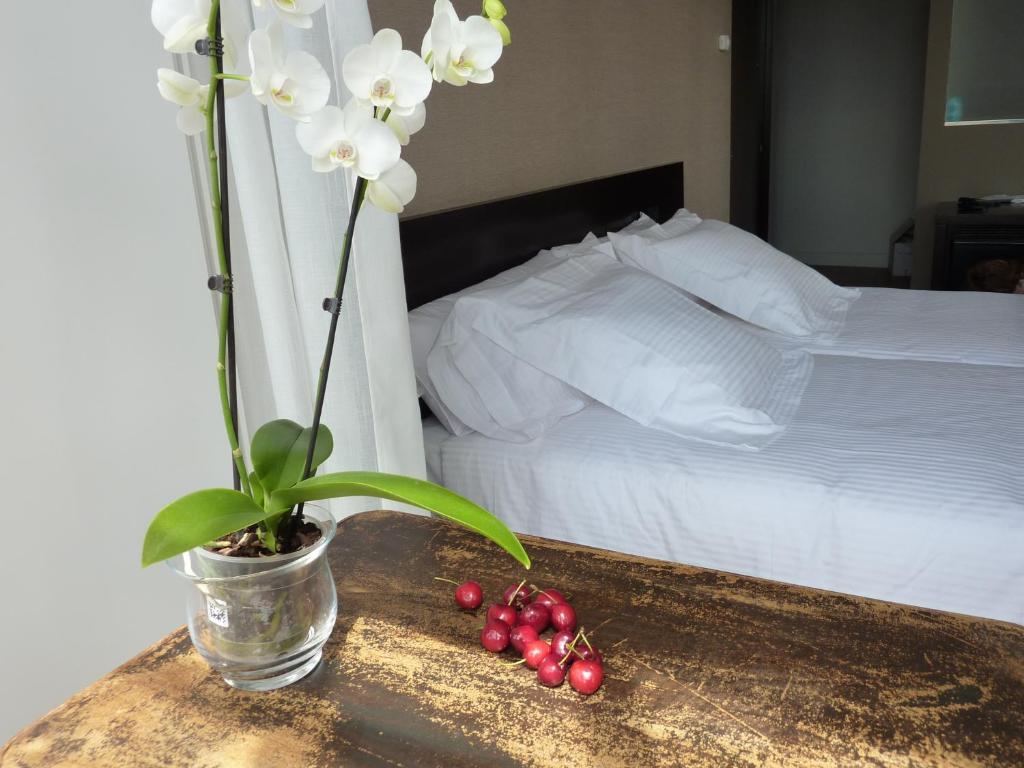 Cama o camas de una habitación en Hotel Gastronómico San Miguel