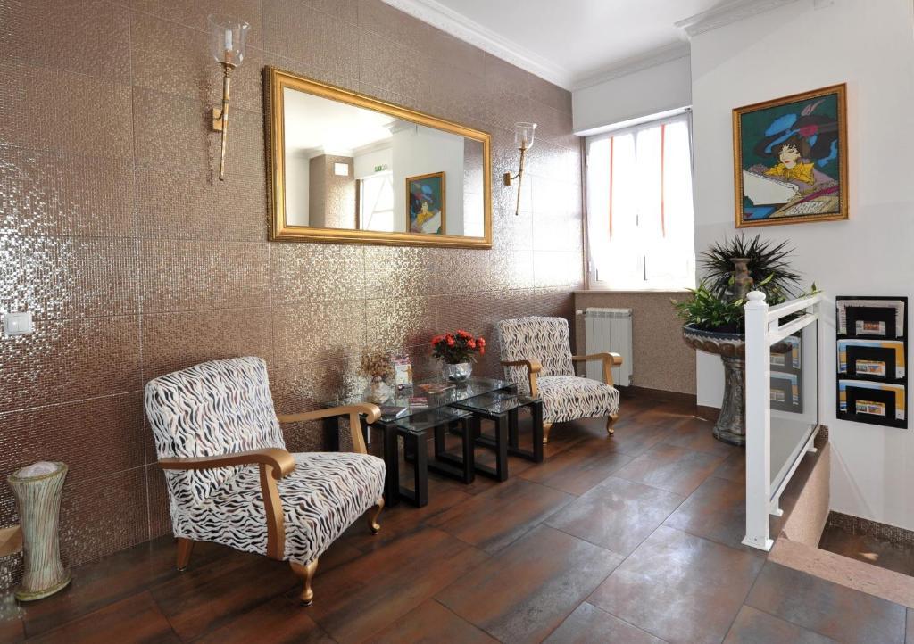 Uma área de estar em Hotel Aviz