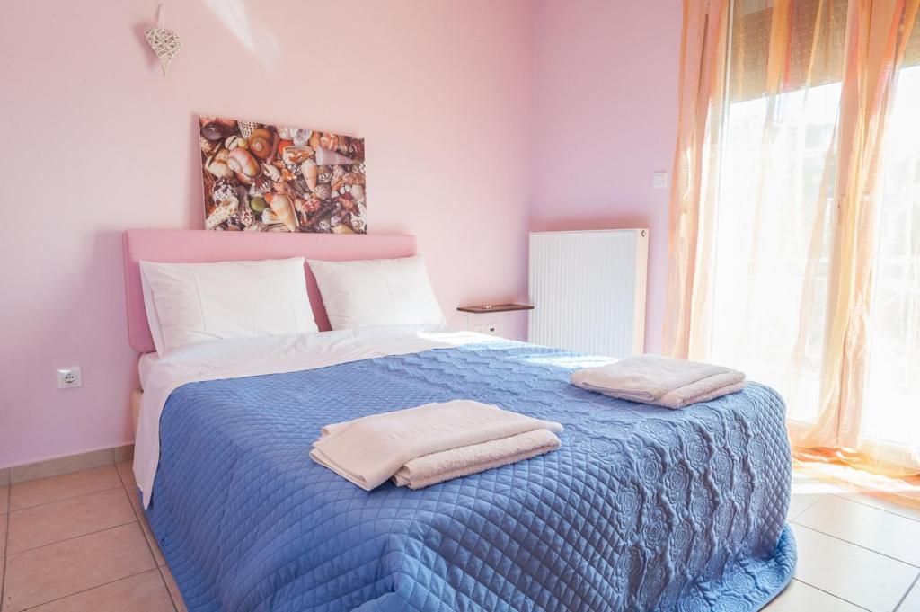 Ένα ή περισσότερα κρεβάτια σε δωμάτιο στο Υψιπύλη