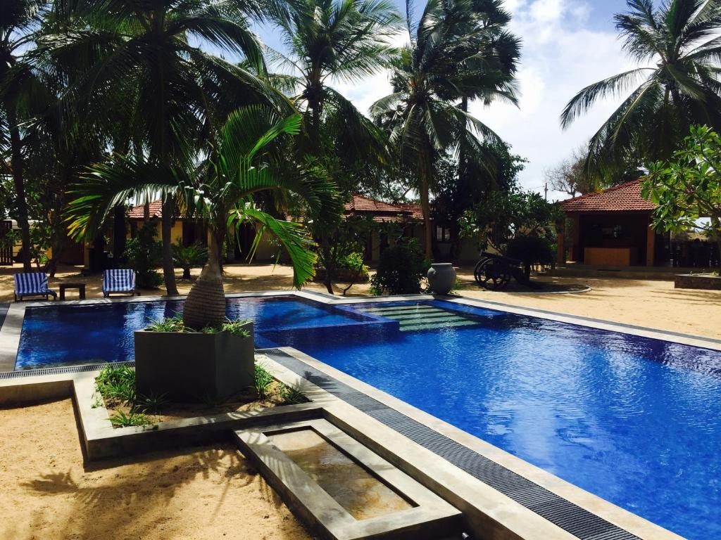 The swimming pool at or close to Horizon Kite Surfing Beach Resort