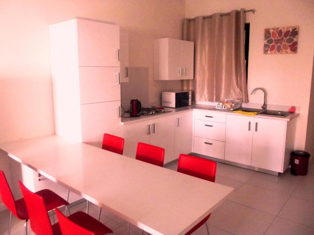 A kitchen or kitchenette at Gorgeous Apartment Beachfront Residences Flic en Flac Mauritius