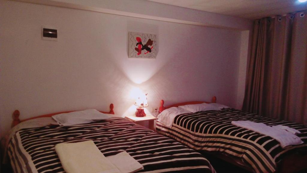 Cama o camas de una habitación en Hospedaje Rosii