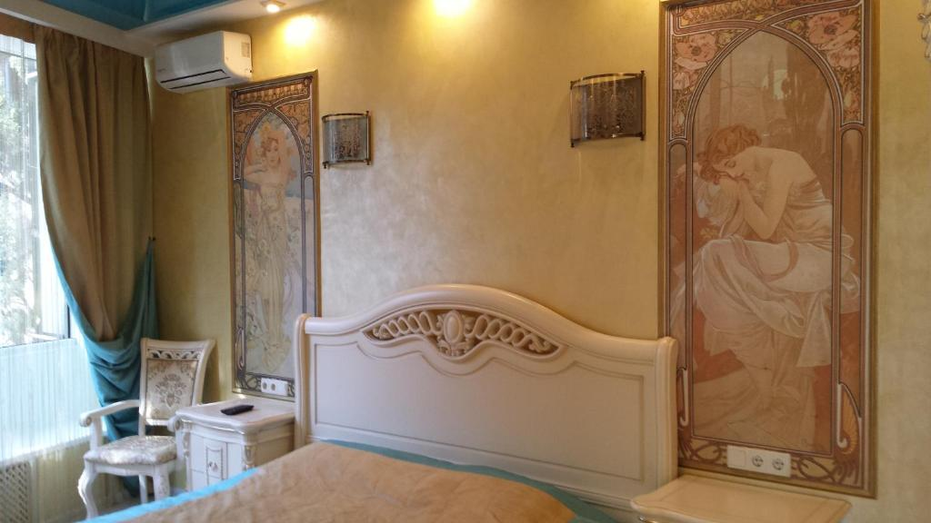 A bed or beds in a room at Apartment in Primorsky Park