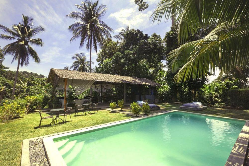 Der Swimmingpool an oder in der Nähe von Mali Samui Resort