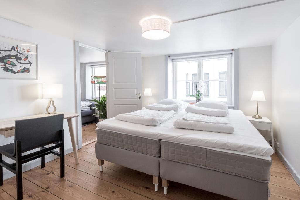 Ein Bett oder Betten in einem Zimmer der Unterkunft Gammeltorv apartments
