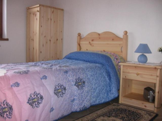 A bed or beds in a room at B&B Edelweiss