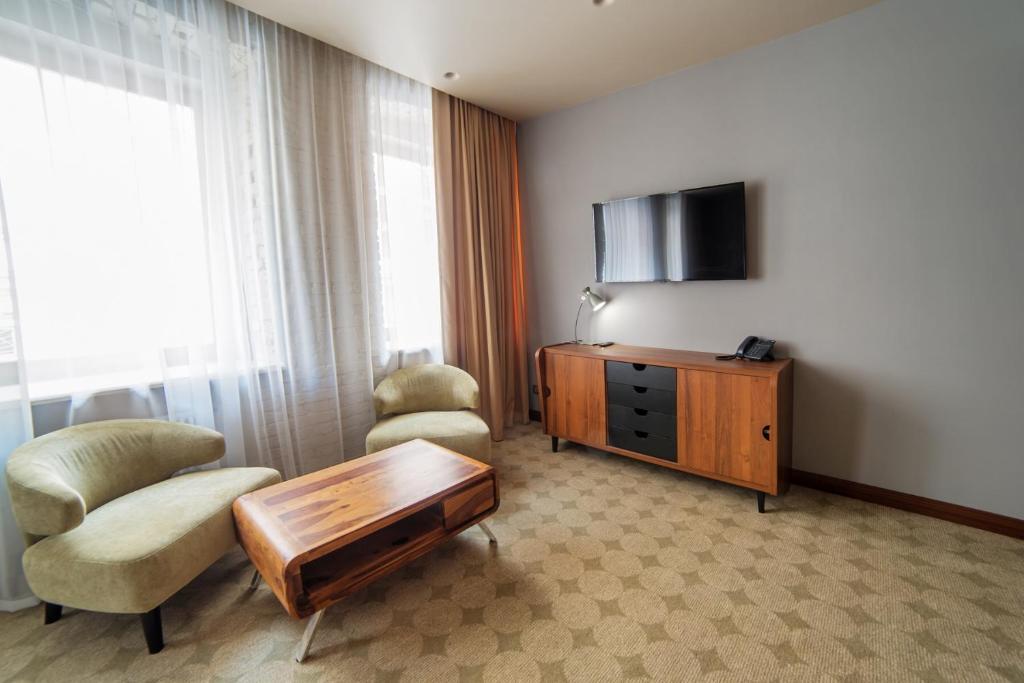 Телевизор и/или развлекательный центр в V Hotel Sadovaya