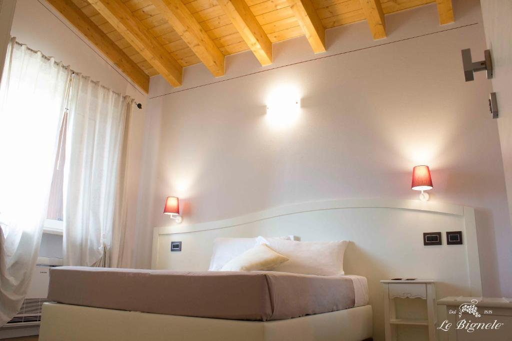 Letto o letti in una camera di Le Bignele