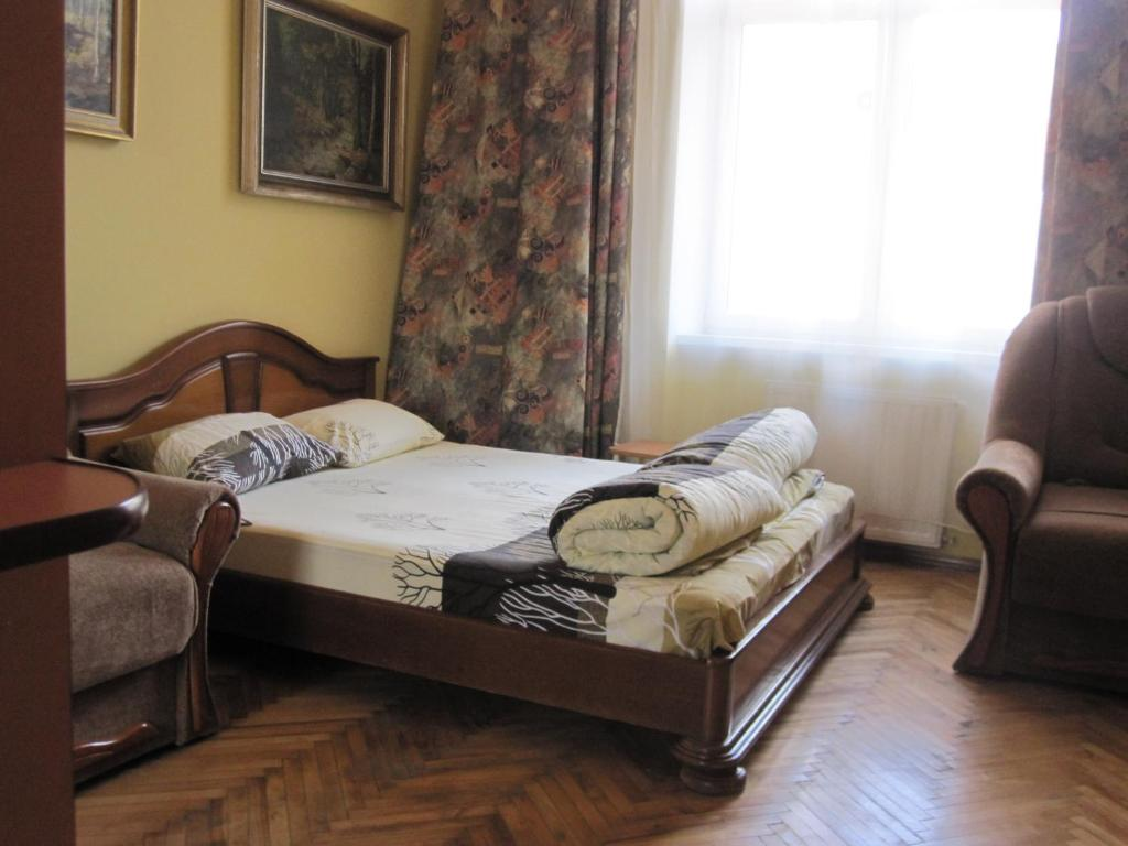 A bed or beds in a room at Hostel Kolibri
