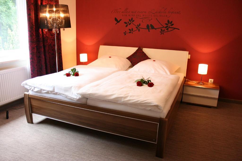 Кровать или кровати в номере Gästehaus Graul
