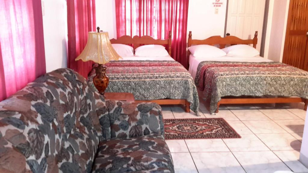 A bed or beds in a room at Top Ranking Hill View Guesthouse