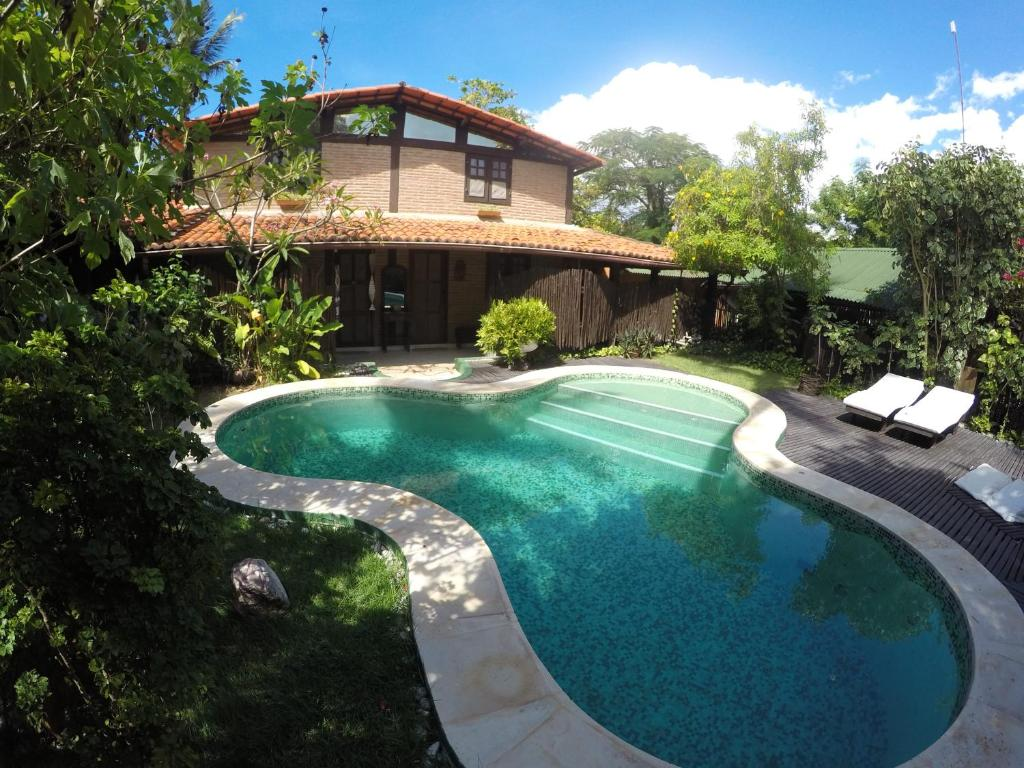 The swimming pool at or near Pousada Ibirapuera