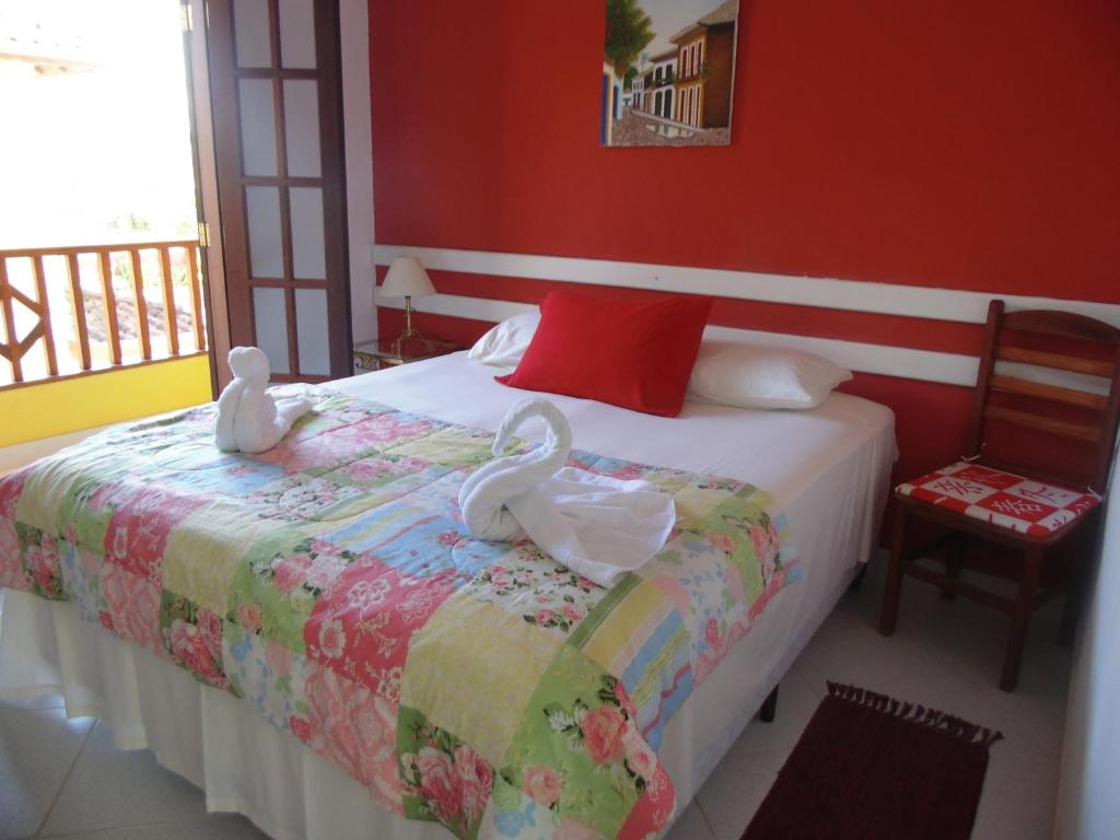 A bed or beds in a room at Pousada Sol e Mar