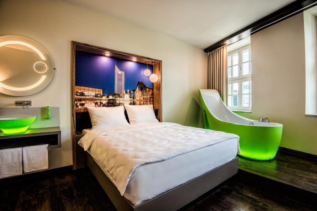 A bed or beds in a room at Travel24 Hotel Leipzig City