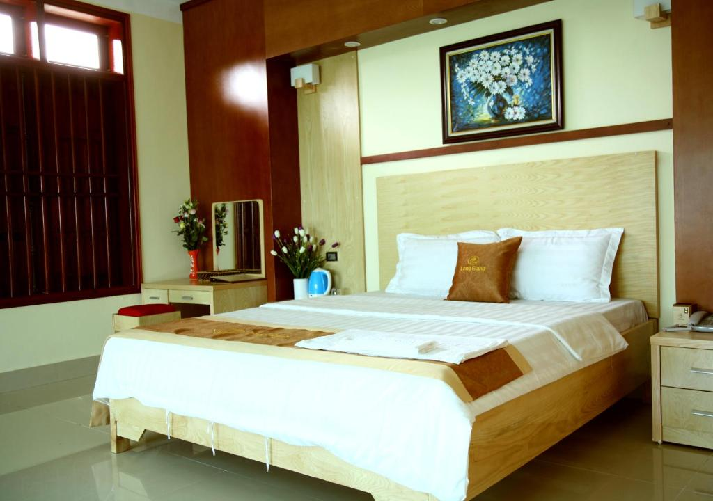 A bed or beds in a room at Long Giang Hotel