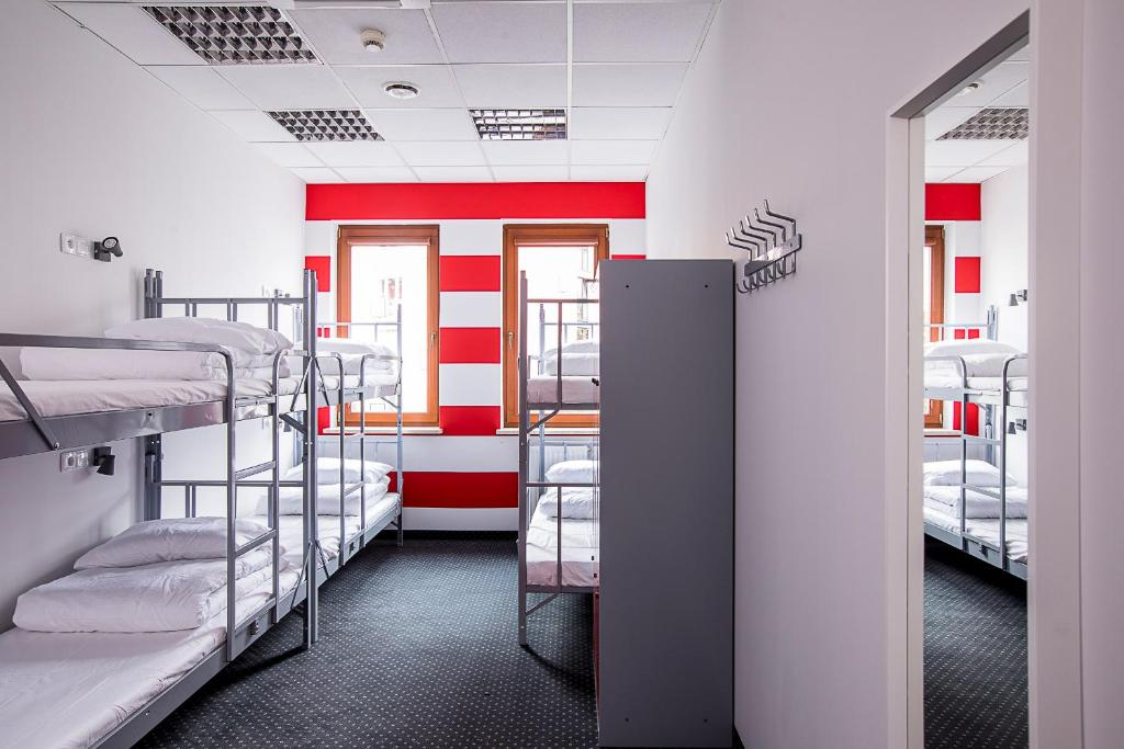 A bunk bed or bunk beds in a room at Inbed Hostel