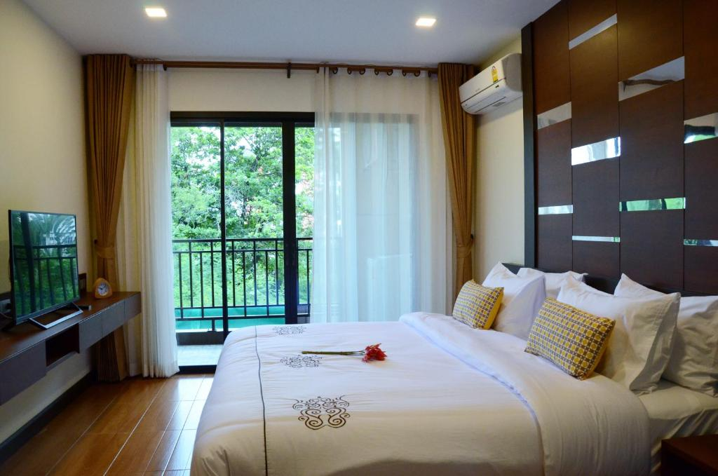 A bed or beds in a room at Luxury Residence