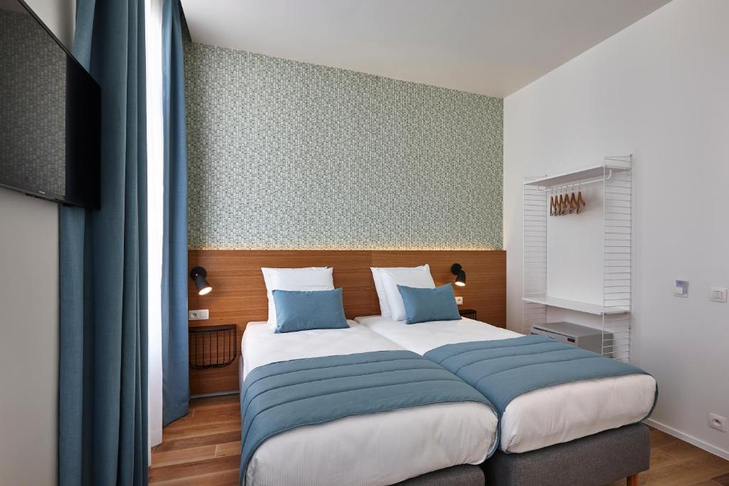 Säng eller sängar i ett rum på Hygge Hotel