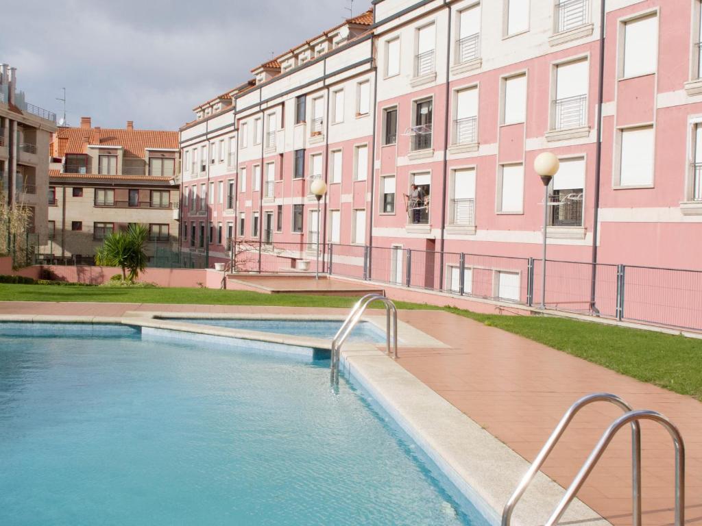 The swimming pool at or near Apartamento La Perla