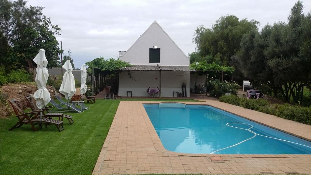 The swimming pool at or near Soeterus Guest Farm