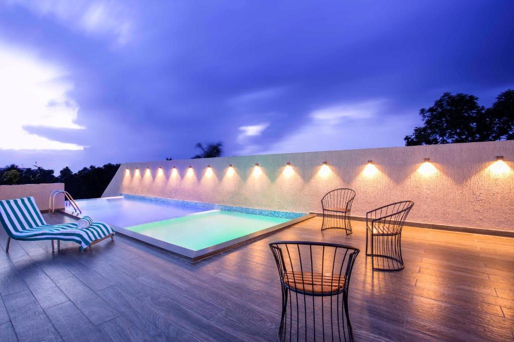 The swimming pool at or near Sidra Pristine Hotel and Portico Halls