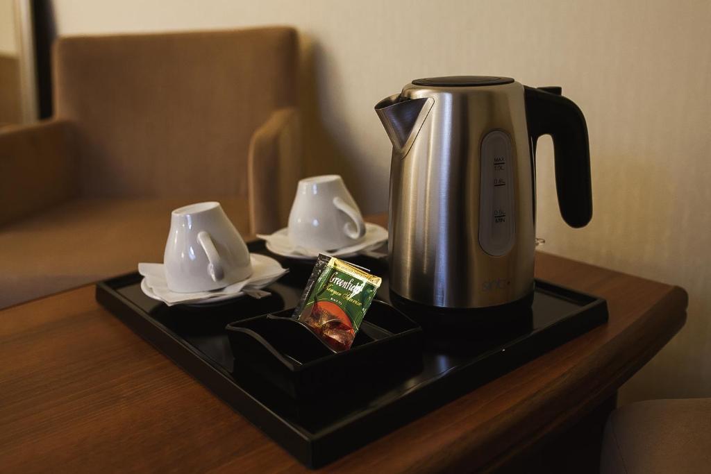 Принадлежности для чая и кофе в Отель Вилладжио
