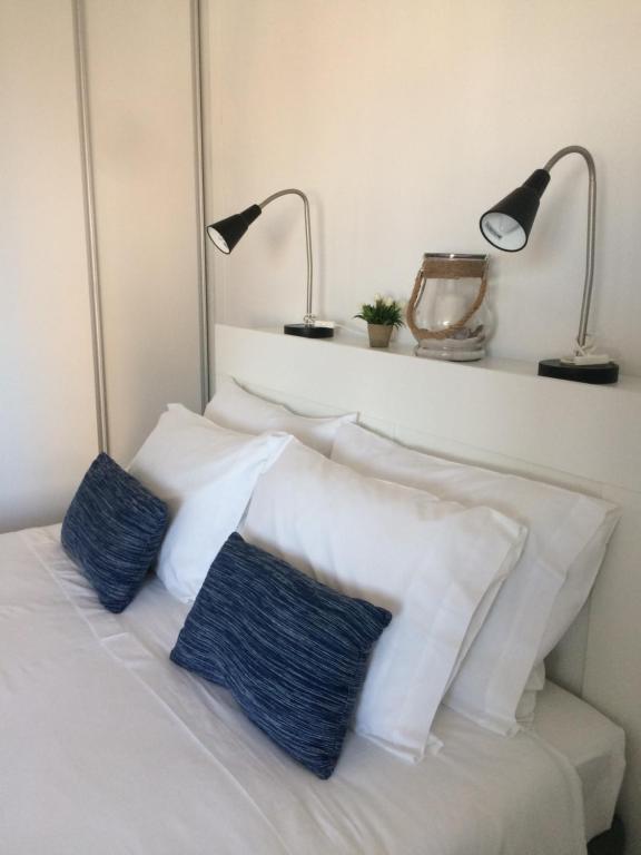 Cama ou camas em um quarto em Aveiro Panoramic