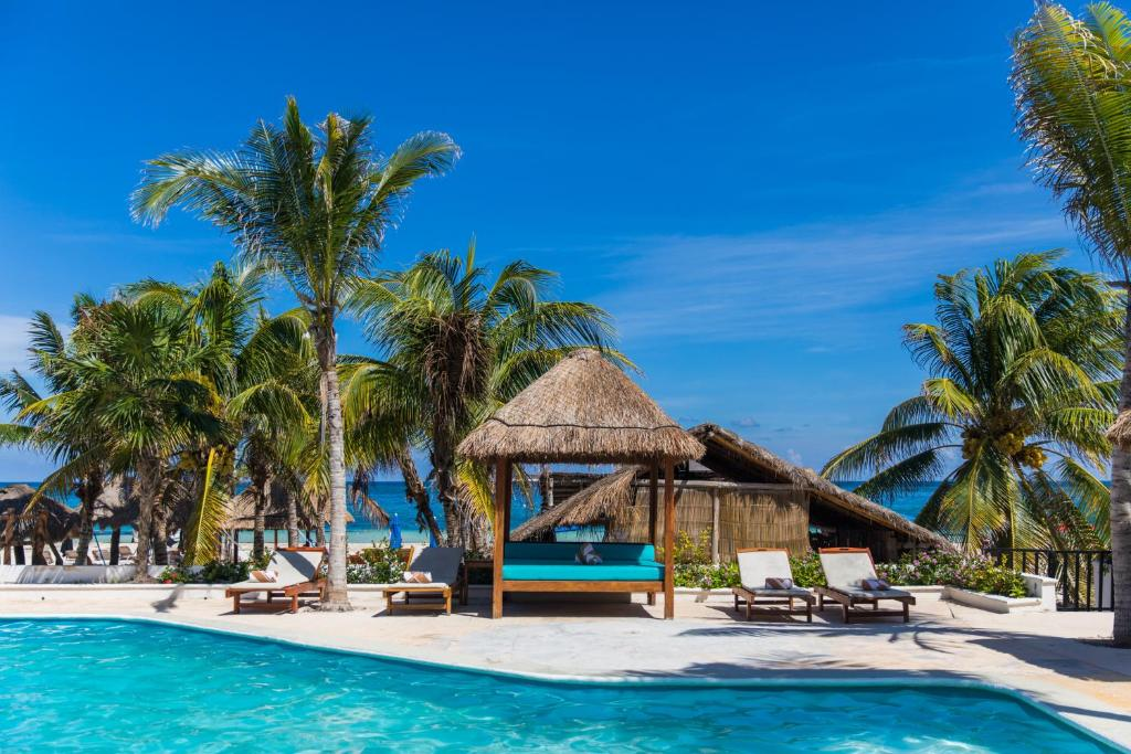 The swimming pool at or near Ojo de Agua Beach Front Hotel