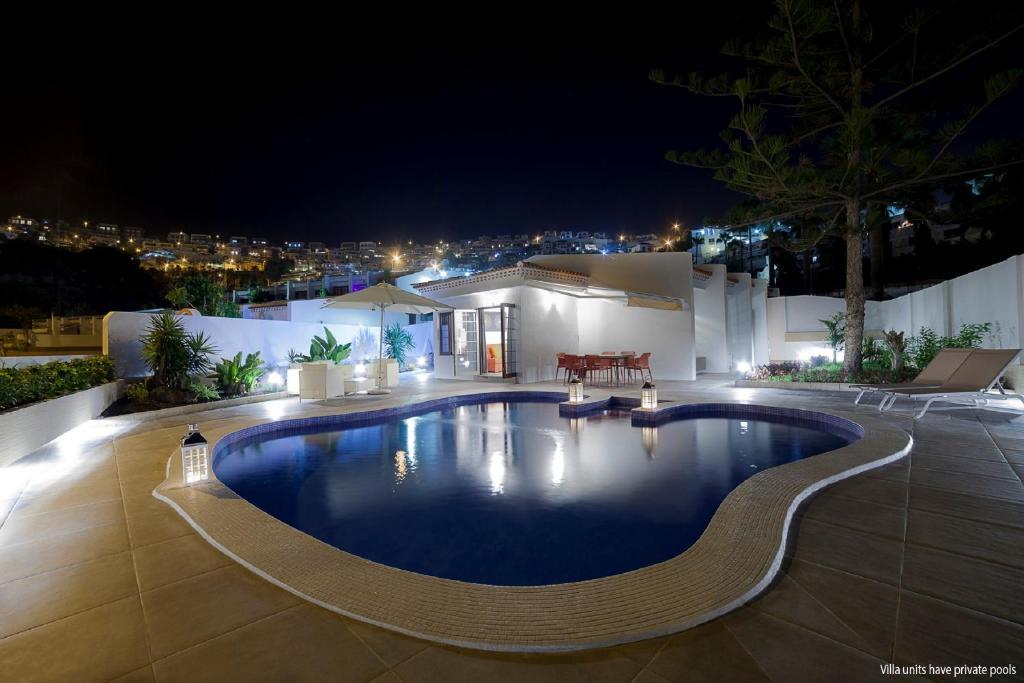 The swimming pool at or near Haciendas IV